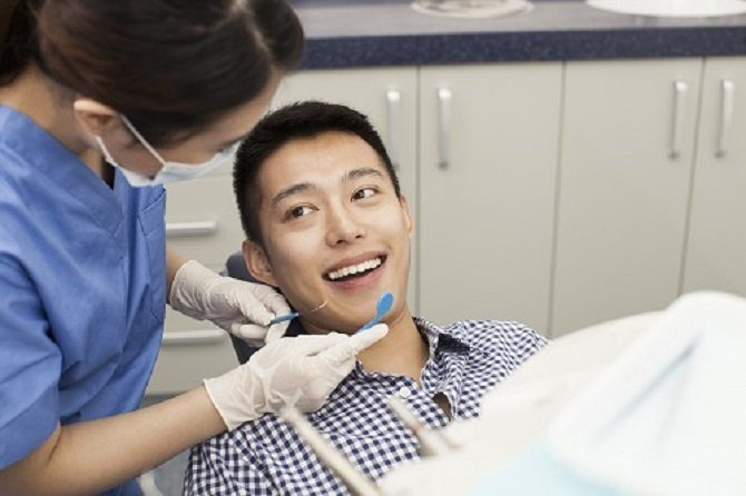 Harrell-Dental-Implant-Center-Charlotte-NC-happy-dental-implant-bridge-results